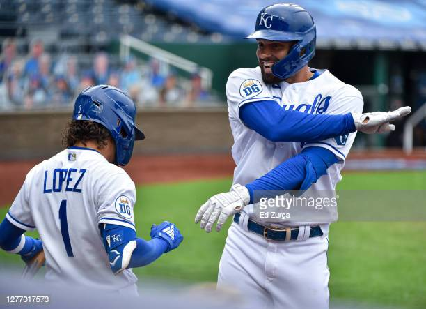 Ryan McBroom of the Kansas City Royals celebrates his home run with Nicky Lopez in the fifth inning against the Detroit Tigers at Kauffman Stadium on...
