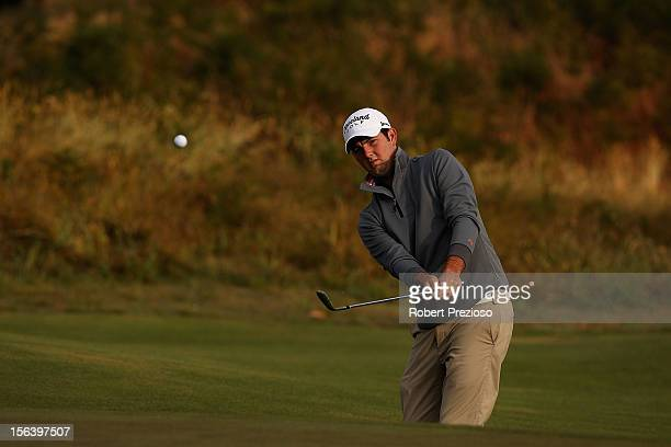 Ryan McCarthy of Australia plays a shot on the 1st hole during day one of the Australian Masters at Kingston Heath Golf Club on November 15, 2012 in...