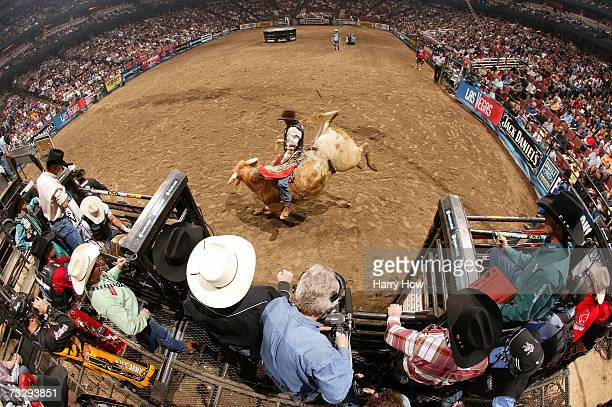 Ryan McConnell attempts to ride a bull during the final of the PBR Amp'd Mobile Invitational in the 2007 Professional Bull Riders Built Ford Tough...
