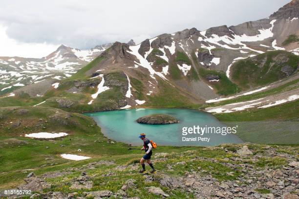 Ryan McDermott runs past Island Lake during the Hardrock 100 endurance run through the San Juan Mountains on July 15 in San Juan County Colorado The...