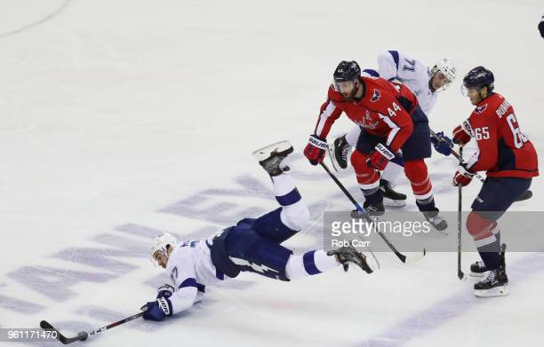 Ryan McDonagh and Anthony Cirelli of the Tampa Bay Lightning skate against Brooks Orpik of the Washington Capitals in the second period of Game Six...