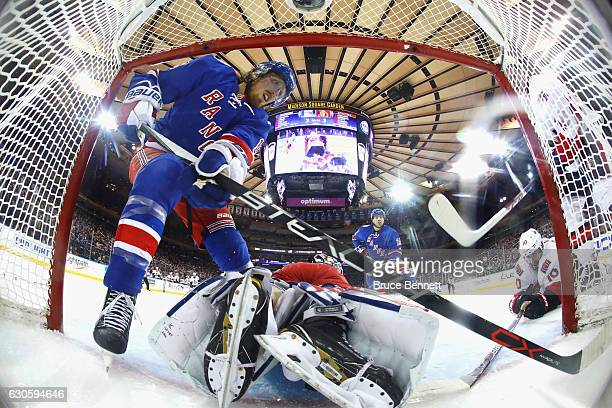 Ryan McDonagh and Antti Raanta of the New York Rangers defend the net against the Ottawa Senators at Madison Square Garden on December 27 2016 in New...