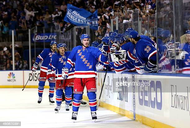 Ryan McDonagh and Carl Hagelin of the New York Rangers celebrate after Hagelin scored a goal against Dustin Tokarski of the Montreal Canadiens in the...