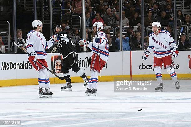 Ryan McDonagh and Dominic Moore of the New York Rangers celebrate after scoring a goal in the first period of Game Two of the Stanley Cup Final...