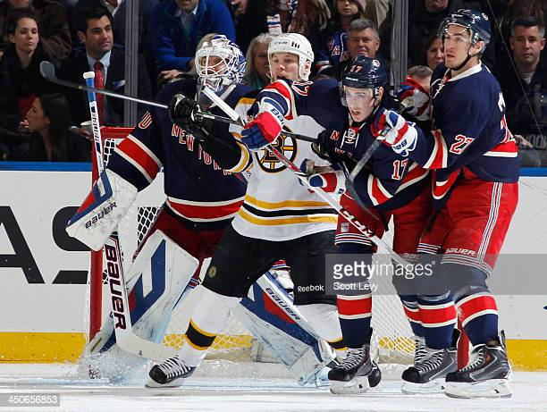 Ryan McDonagh and John Moore of the New York Rangers battle for position in front of Henrik Lundqvist of the New York Rangers with Shawn Thornton of...