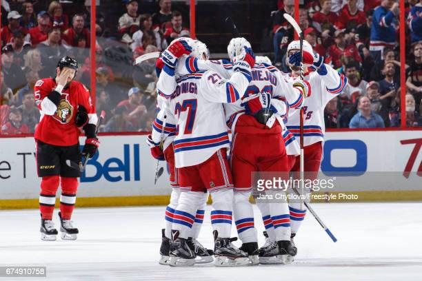 Ryan McDonagh and Mika Zibanejad of the New York Rangers celebrates a second period goal by Brady Skjei as Zack Smith of the Ottawa Senators reacts...