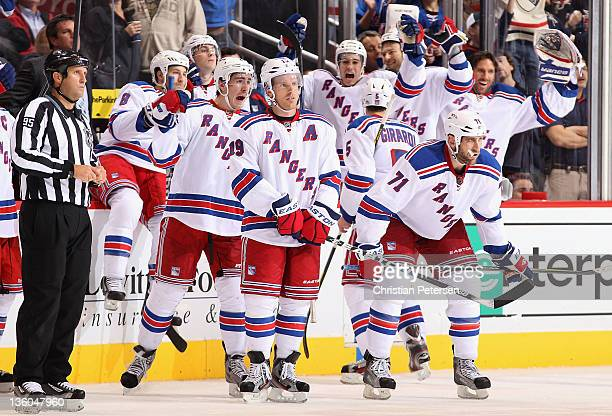Ryan McDonagh, Brad Richards and Mike Rupp of the New York Rangers celebrate after Richards scored on a reviewed goal in the final second of the NHL...