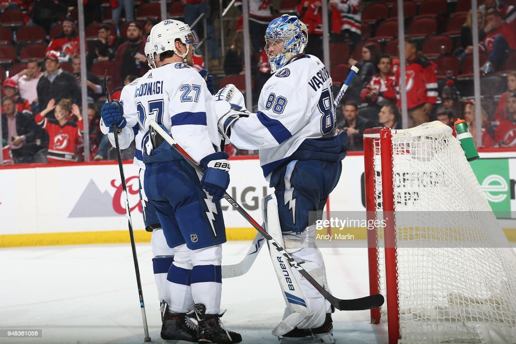 Ryan McDonagh #27 congratulates Andrei Vasilevskiy #88 of the Tampa Bay Lightning on their win over the New Jersey Devils in Game Four of the Eastern Conference First Round during the 2018 NHL Stanley Cup Playoffs at Prudential Center on April 18, 2018 in Newark, New Jersey. The Lightning defeated the Devils 3-1.