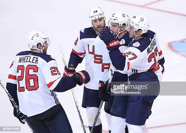 Ryan McDonagh of Team USA is congratulated on his goal by Brandon Dubinsky and Matt Niskanen and Blake Wheeler against Team Czech Republic during the...