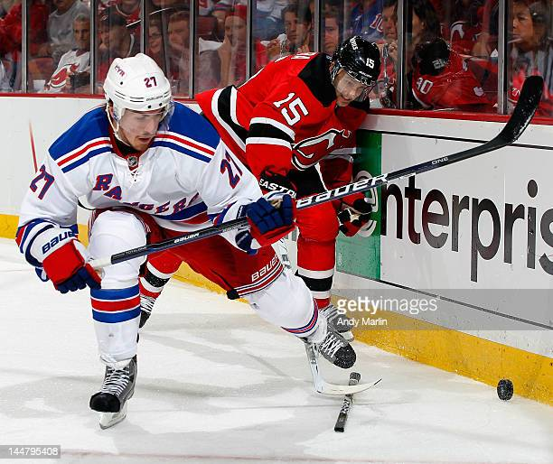 Ryan McDonagh of the New York Rangers and Petr Sykora of the New Jersey Devils battle for a loose puck along the boards in Game Three of the Eastern...