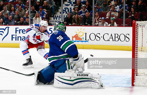 Ryan McDonagh of the New York Rangers beats Ryan Miller of the Vancouver Canucks for a goal during their NHL game at Rogers Arena December 13 2014 in...