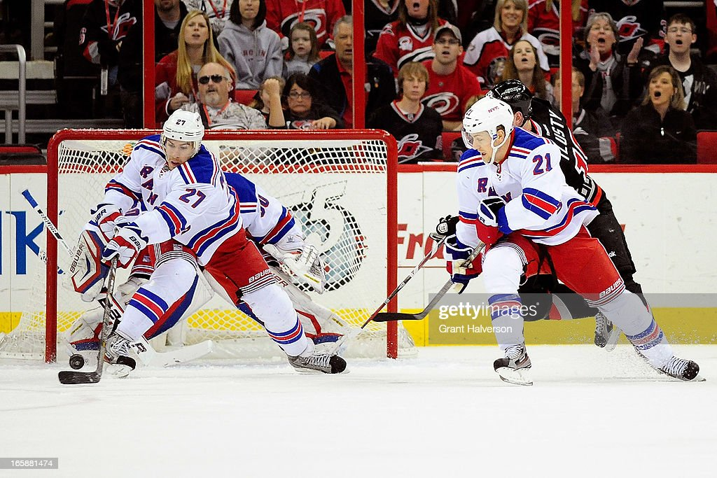 Ryan McDonagh #27 of the New York Rangers blocks a shot by the Carolina Hurricanes during play at PNC Arena on April 6, 2013 in Raleigh, North Carolina.
