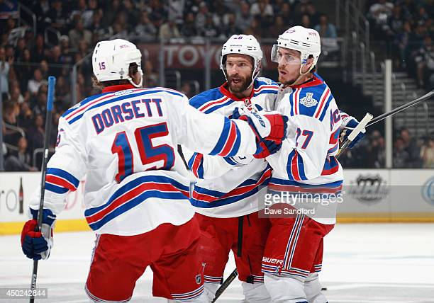 Ryan McDonagh of the New York Rangers celebrates his goal against the Los Angeles Kings with teammates Derek Dorsett and Dominic Moore during the...