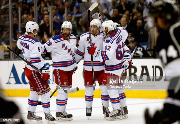 Ryan McDonagh of the New York Rangers celebrates his goal against the Los Angeles Kings with teammates Carl Hagelin Anton Stralman and Dominic Moore...