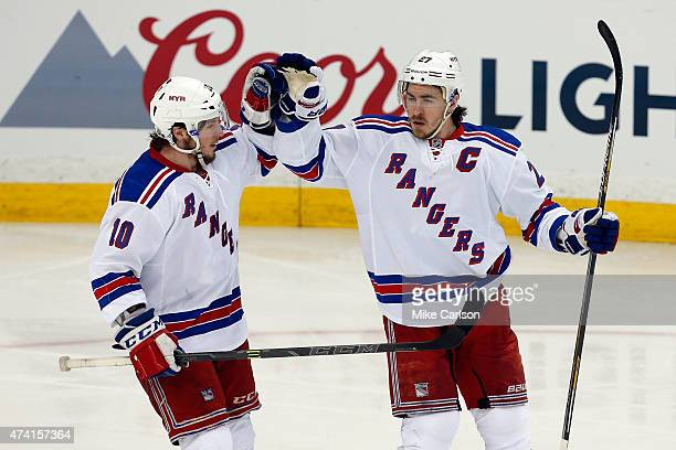 Ryan McDonagh of the New York Rangers celebrates with teammate JT Miller after scoring a goal in the third period against Ben Bishop of the Tampa Bay...