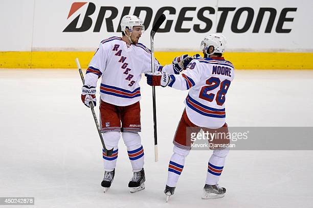 Ryan McDonagh of the New York Rangers celebrates with teammate Dominic Moore after McDonagh scores a first period goal against the Los Angeles Kings...