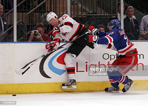 Ryan McDonagh of the New York Rangers checeks Ilya Kovalchuk of the New Jersey Devils into the boards at Madison Square Garden on February 27, 2012...