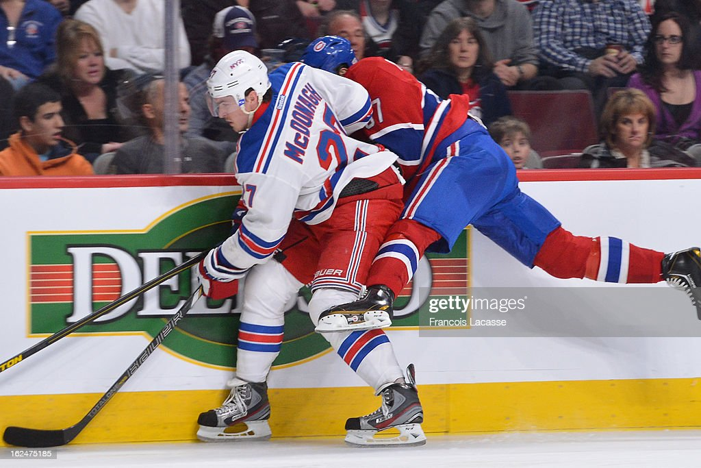 Ryan McDonagh #27 of the New York Rangers checks Max Pacioretty #67 of the Montreal Canadiens in the boards during the NHL game on February 23, 2013 at the Bell Centre in Montreal, Quebec, Canada.