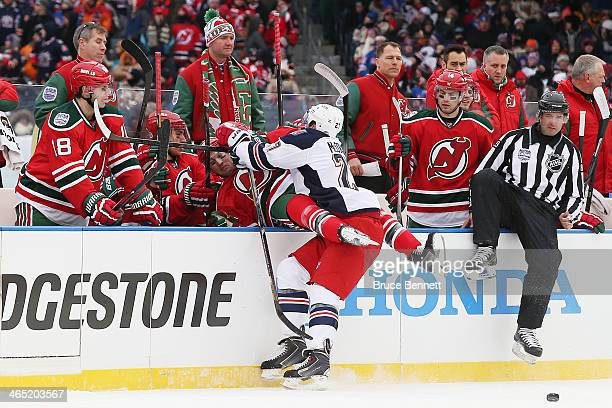 Ryan McDonagh of the New York Rangers checks Travis Zajac of the New Jersey Devils in the first period during the 2014 Coors Light NHL Stadium Series...