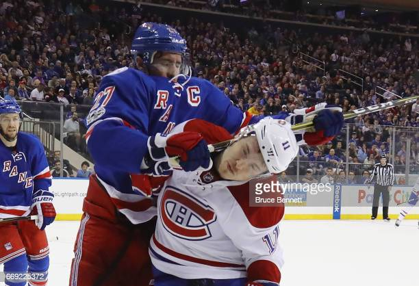 Ryan McDonagh of the New York Rangers gets the stick up on Brendan Gallagher of the Montreal Canadiens during the third period in Game Three of the...