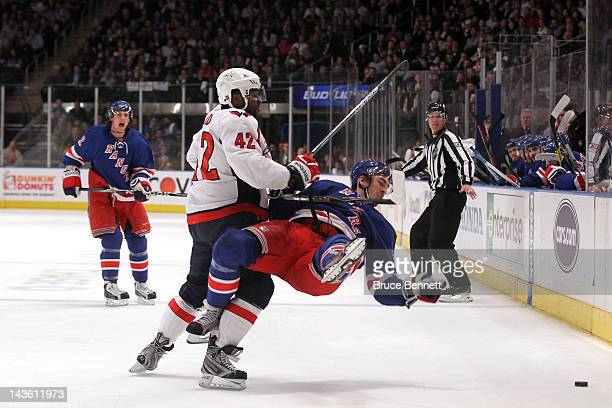 Ryan McDonagh of the New York Rangers is checked to the ice in the second period by Joel Ward of the Washington Capitals in Game Two of the Eastern...