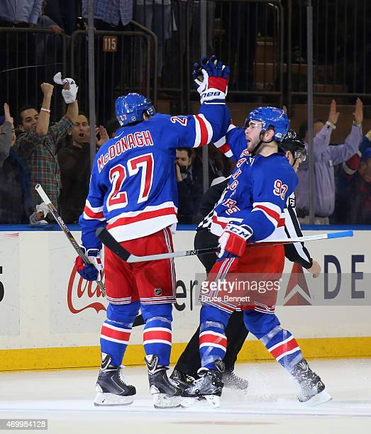 Ryan McDonagh of the New York Rangers scores a powerplay goal at 15:16 of the first period against the Pittsburgh Penguins and is joined by Keith...