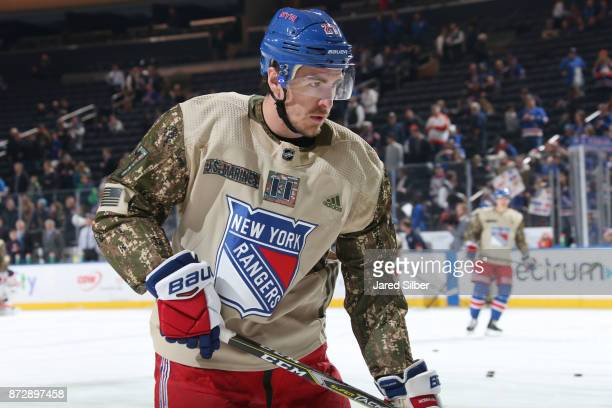 Ryan McDonagh of the New York Rangers sports a special jersey during warmups in honor of Veterans Day prior to the game against the Edmonton Oilers...