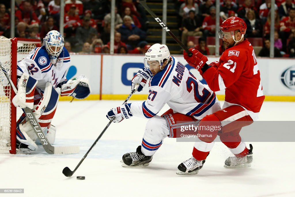 Ryan McDonagh #27 of the New York Rangers tries to turn away from Tomas Tatar #21 of the Detroit Red Wings during the first period at Joe Louis Arena on March 12, 2017 in Detroit, Michigan.