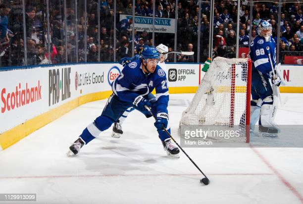 Ryan McDonagh of the Tampa Bay Lightning battles for the puck against Trevor Moore of the Toronto Maple Leafs during the first period at the...