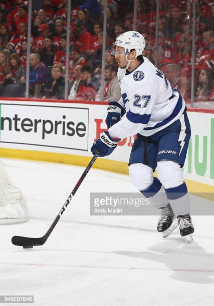 Ryan McDonagh of the Tampa Bay Lightning plays the puck against the New Jersey Devils in Game Four of the Eastern Conference First Round during the...