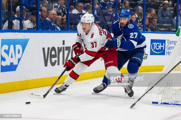 Ryan McDonagh of the Tampa Bay Lightning skates against Andrei Svechnikov of the Carolina Hurricanes during the second period in Game Four of the...