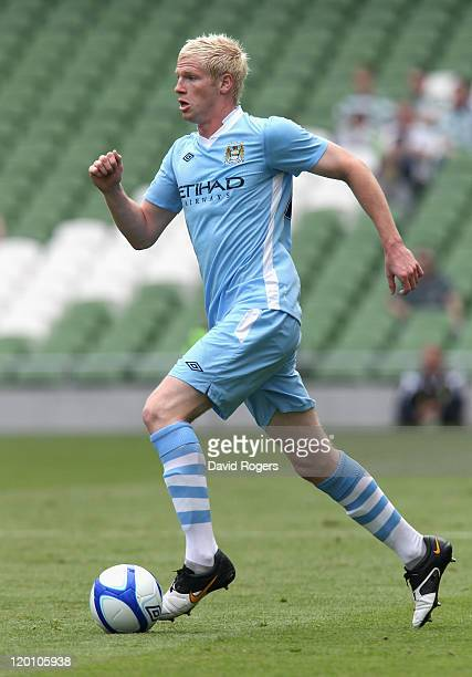 Ryan McGivern of Manchester City runs with the ball during the Dublin Super Cup match between Manchester City and Airtricity XI at Aviva Stadium on...