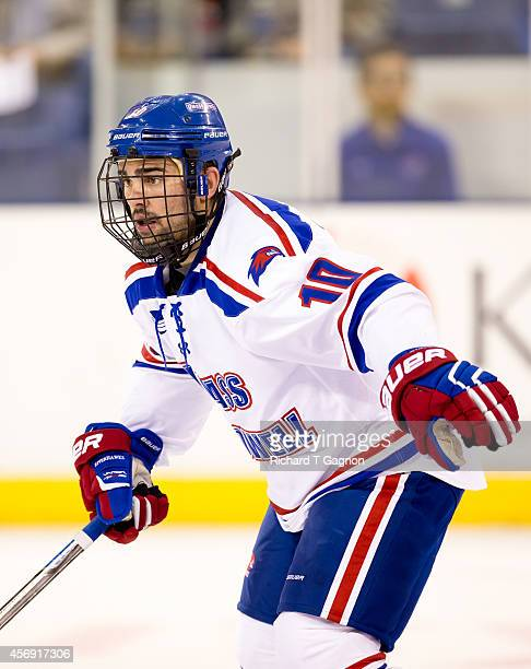 Ryan McGrath of the Massachusetts Lowell River Hawks skates against the St. Thomas University Tommies during NCAA exhibition hockey at the Tsongas...