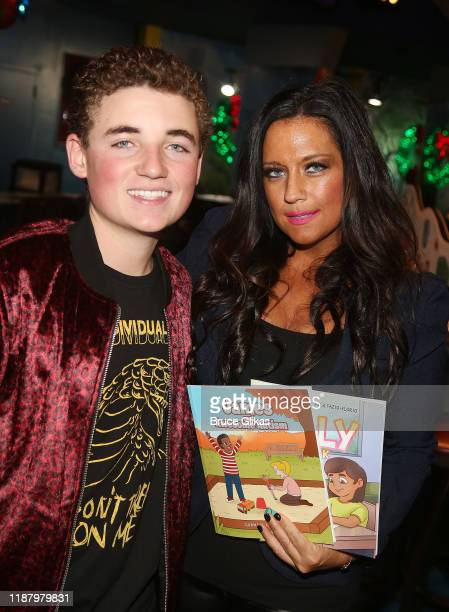 Ryan McKenna aka The Selfie Kid and Author Carmela Florio pose during a launch event promoting his Selfie Kid X Brooklyn Cloth Limited Edition TShirt...