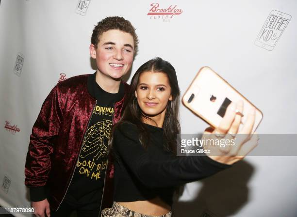 Ryan McKenna aka The Selfie Kid and Gianna Ferazi pose during a launch event promoting his Selfie Kid X Brooklyn Cloth Limited Edition TShirt...