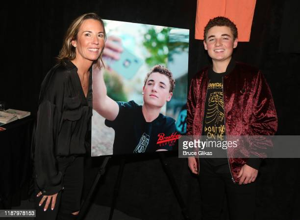 Ryan McKenna aka The Selfie Kid and his mother Tracy McKenna pose during a launch event promoting his Selfie Kid X Brooklyn Cloth Limited Edition...