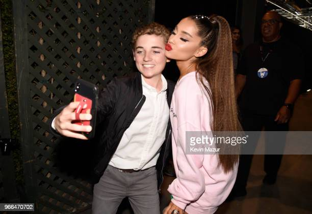 Ryan McKenna and Ariana Grande pose for a selfie photo backstage at the 2018 iHeartRadio Wango Tango by ATT at Banc of California Stadium on June 2...