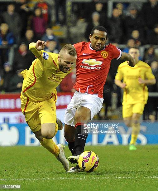 Ryan McLaughlin of Liverpool and Anderson of Manchester United in action during the Barclays U21 Premier League match between Manchester United and...