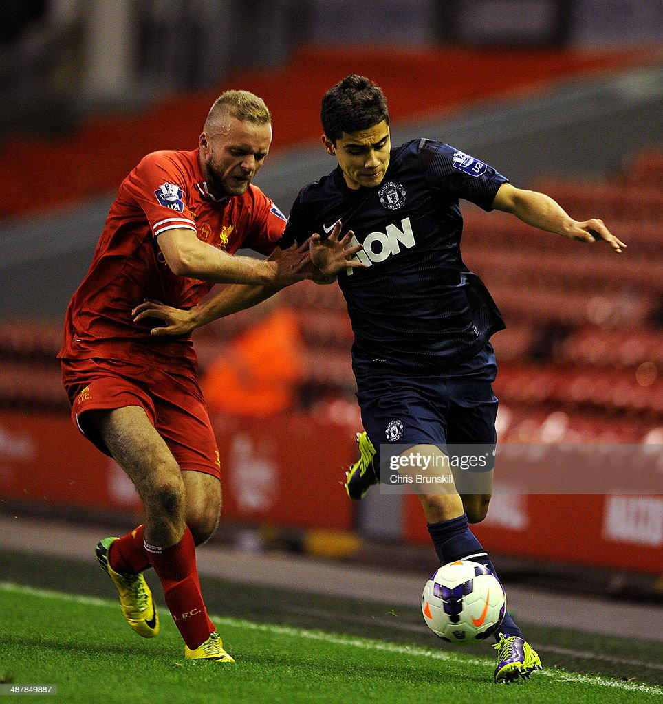 Ryan McLaughlin of Liverpool in action with Andreas Pereira of Manchester United during the Barclays U21 Premier League Semi Final match between Liverpool and Manchester United at Anfield on May 02, 2014 in Liverpool, England.