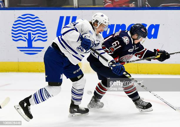 Ryan McLeod of the Mississauga Steelheads battles with Allan McShane of the Oshawa Generals during OHL game action on December 7 2018 at Paramount...