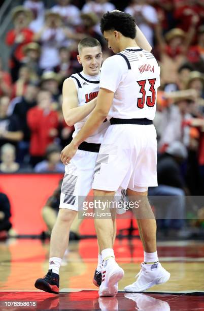 Ryan McMahon and Jordan Nwora of the Louisville Cardinals celebrate in the game against the Miami Hurricanes at KFC YUM Center on January 6 2019 in...