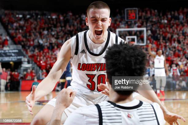 Ryan McMahon and Jordan Nwora of the Louisville Cardinals celebrate against the Pittsburgh Panthers in the second half of the game at KFC YUM Center...