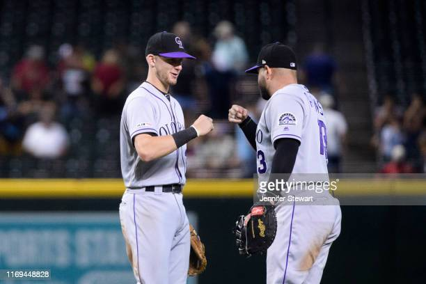 Ryan McMahon and Yonder Alonso of the Colorado Rockies celebrate after defeating the Arizona Diamondbacks 72 in the ninth inning of the MLB game at...
