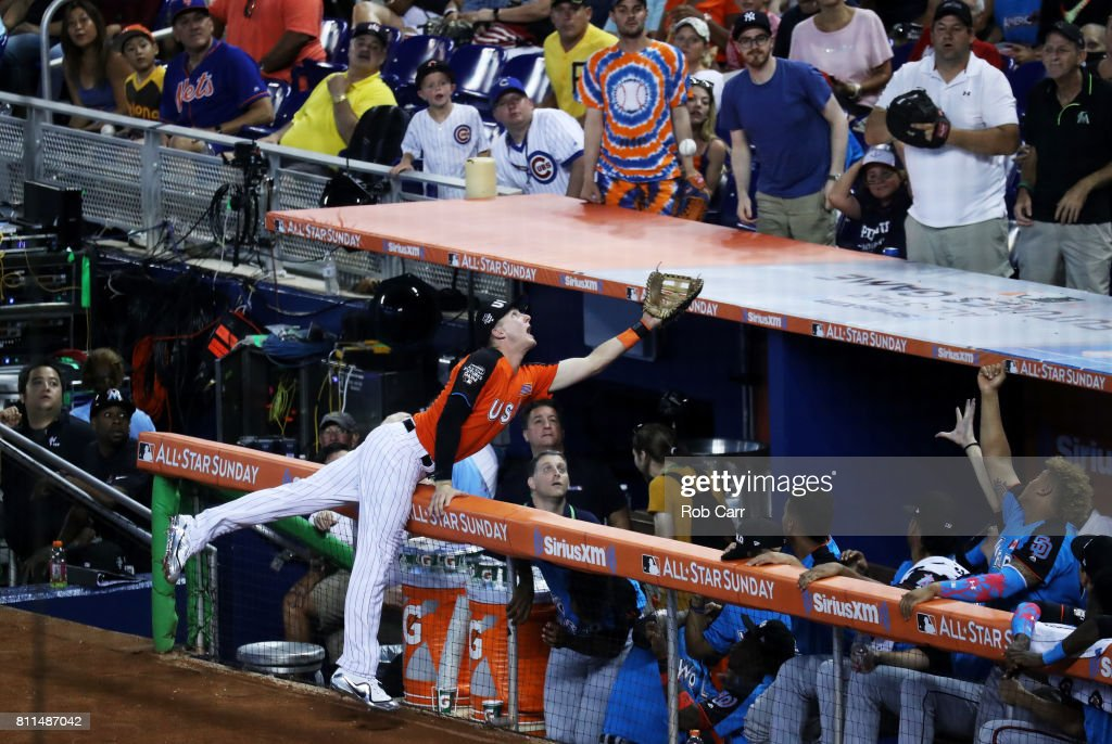 Ryan McMahon #9 of the Colorado Rockies and the U.S. Team catches a ball hit by Vladimir Guerrero Jr. #27 of the Toronto Blue Jays and the World Team for an out in the ninth inning during the SiriusXM All-Star Futures Game at Marlins Park on July 9, 2017 in Miami, Florida.