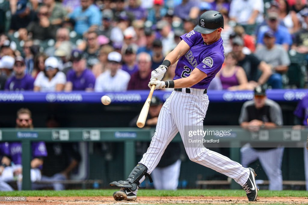 Ryan McMahon #24 of the Colorado Rockies hits an RBI double against the Oakland Athletics during interleague play at Coors Field on July 29, 2018 in Denver, Colorado.