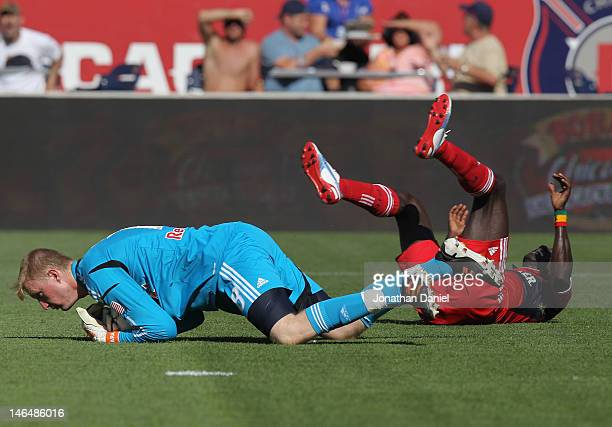 Ryan Meara of the New York Red Bulls makes a save against Dominic Oduro of the Chicago Fire who lands on his back during an MLS match at Toyota Park...