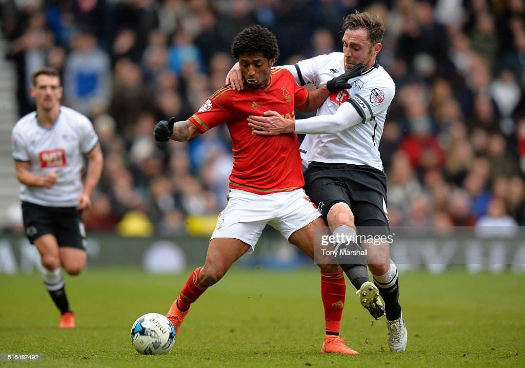 Ryan Mendes of Nottingham Forest and Richard Keogh of Derby County compete for the ball during the Sky Bet Championship match between Derby County and Nottingham Forest at the iPro Stadium on March 19, 2016 in Derby, United Kingdom.