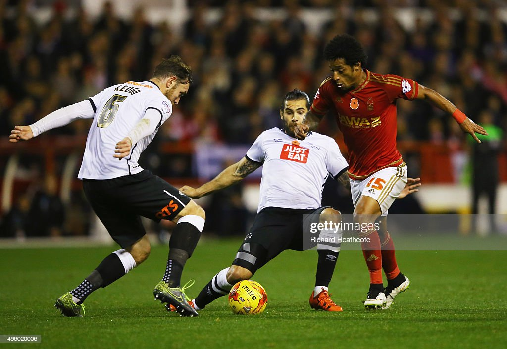Ryan Mendes of Nottingham Forest takes on Richard Keogh (L) and Bradley Johnson of Derby County (C) during the Sky Bet Championship match between Nottingham Forest and Derby County at City Ground on November 6, 2015 in Nottingham, England.