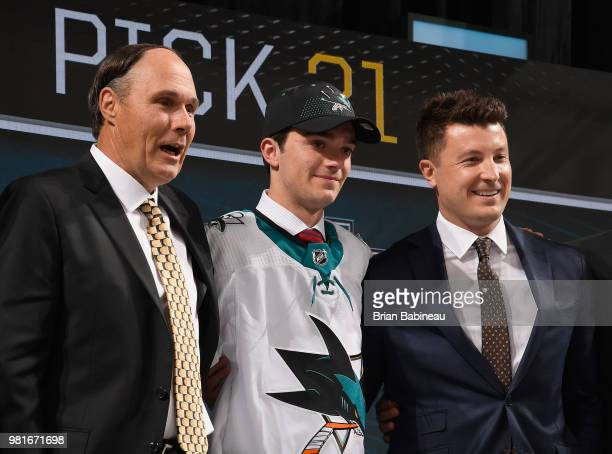 Ryan Merkley poses with team personnel after being selected twentyfirst overall by the San Jose Sharks during the first round of the 2018 NHL Draft...