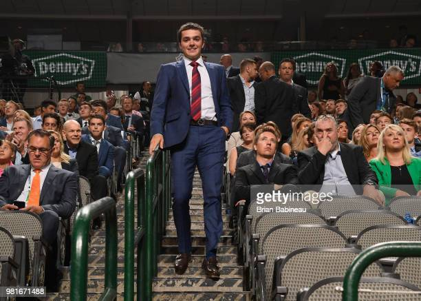 Ryan Merkley walks to the draft floor after being selected twentyfirst overall by the San Jose Sharks during the first round of the 2018 NHL Draft at...
